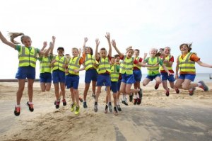 Pupils running mile-a-day take to beach to help fund new track