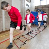 Coaches Teaching PE Lessons In Primary Schools